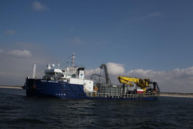 """Baltijos jūroje pradedamas tiesti elektros jungties """"Nord Balt"""" kabelis"""